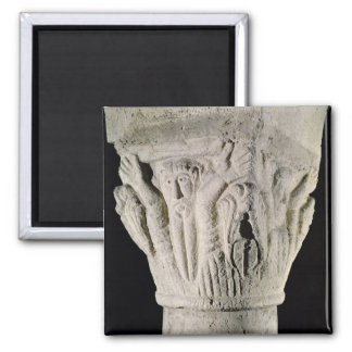 Column capital with a man with raised arms magnet