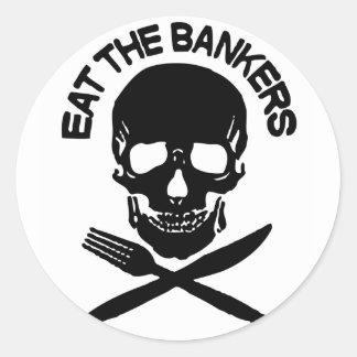 coma a los banqueros cráneo y huesos etiquetas redondas
