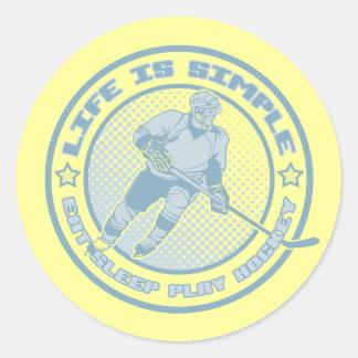 Coma, duerma, juegue a los pegatinas del hockey etiquetas redondas