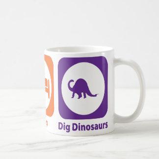 Coma los dinosaurios del empuje del sueño taza