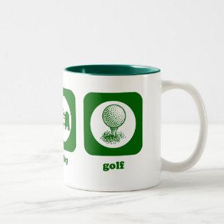 Coma. Sueño. Golf. Taza