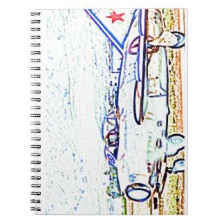 Combatiente del Mig 15 en un cuaderno