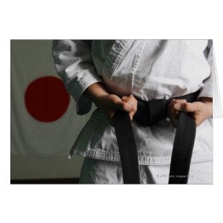 Combatiente del Taekwondo que tensa la correa Tarjeta De Felicitación