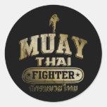 Combatiente tailandés de Muay del oro Etiqueta Redonda
