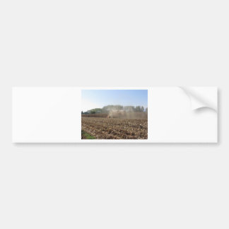 Combine harvesting corn crop in cultivated field bumper sticker