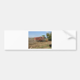 Combine harvesting corn crop in the field bumper sticker