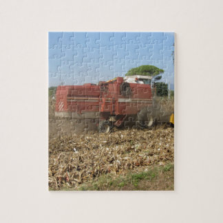 Combine harvesting corn crop in the field jigsaw puzzle