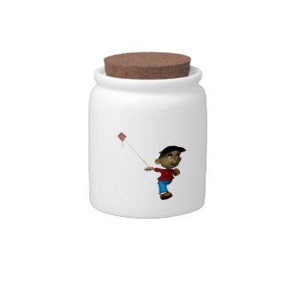 Cometa del vuelo del muchacho jarras para caramelos