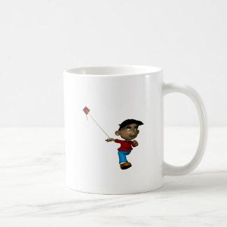Cometa del vuelo del muchacho taza de café
