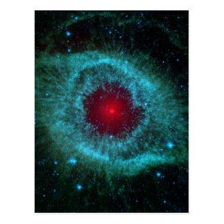 Comets Kick Up Dust in Helix Nebula Postcard