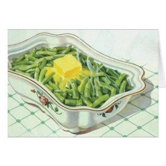 Comida del vintage, cazuela de la haba verde con tarjeta de felicitación