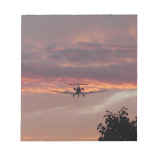 Commercial Jet Landing At Sunset Notepad