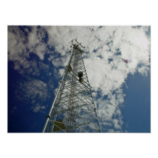 Communications tower reaching for the clouds poster