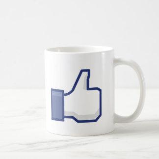 Como la mano taza de café