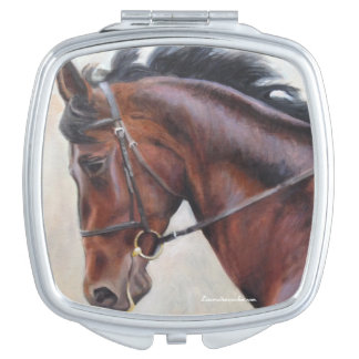 Compact mirror with dark brown horse head