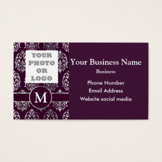 Company logo and purple and silver damask business card