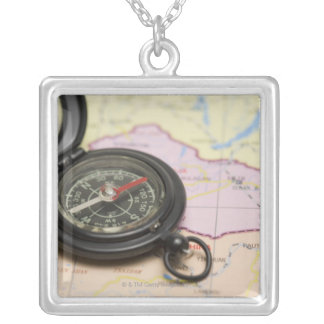 Compass on a map 2 silver plated necklace