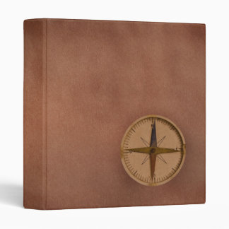 compass on old paper 3 ring binder