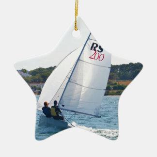 Competir con el bote a la velocidad adorno navideño de cerámica en forma de estrella