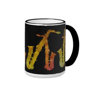 Compinches naranja y oro del saxofón en negro tazas de café