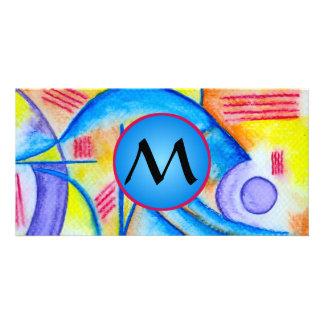 Composición alegre con el monograma azul tarjeta fotografica