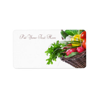Composición con las verduras crudas etiqueta de dirección