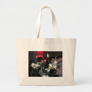 Composición de flores bolsa tela grande