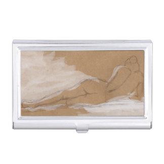 Composición desnuda femenina que miente en cama cajas de tarjetas de negocios