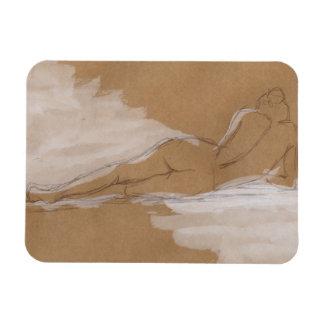 Composición desnuda femenina que miente en cama imán