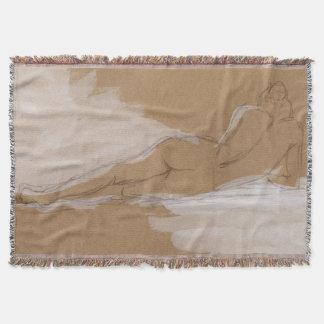 Composición desnuda femenina que miente en cama manta