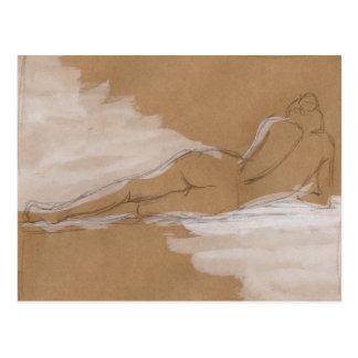 Composición desnuda femenina que miente en cama postales
