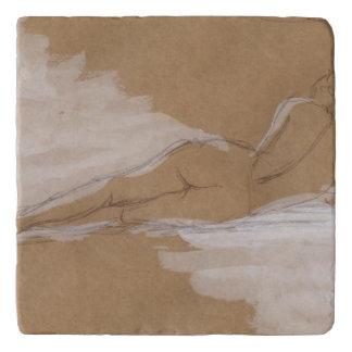 Composición desnuda femenina que miente en cama salvamanteles