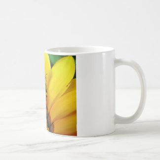 Composition in yellow coffee mug