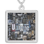 Composition of letterpress blocks silver plated necklace