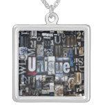 Composition of letterpress blocks square pendant necklace