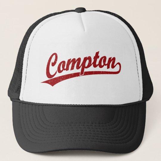 Compton script logo in red trucker hat