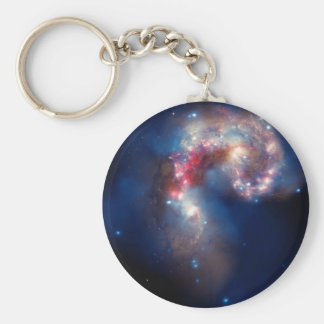 Compuesto colorido de las galaxias de las antenas llavero redondo tipo pin