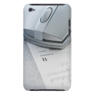 Computer mouse on written prescription iPod touch covers