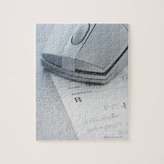 Computer mouse on written prescription jigsaw puzzle
