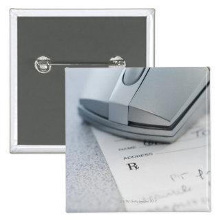 Computer mouse on written prescription pinback button