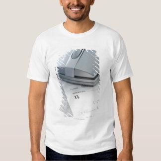Computer mouse on written prescription t shirt