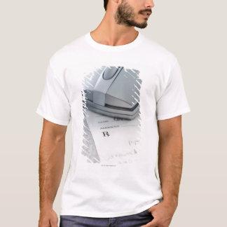 Computer mouse on written prescription T-Shirt