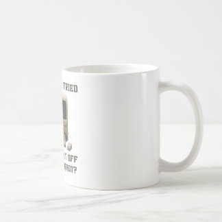 Computer turning it off and one again coffee mug