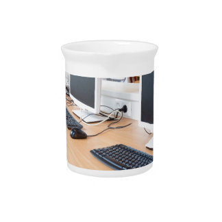 Computers in classroom on high school beverage pitcher
