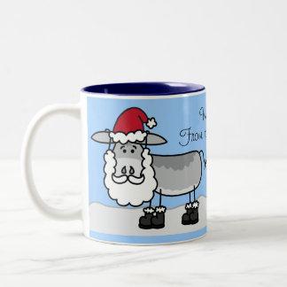 Con la taza del navidad de los pares del burro del