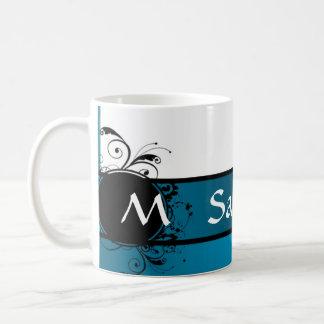 Con monograma azul del trullo taza