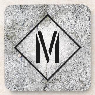 Con monograma concreto gris fotorrealista posavasos