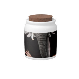 Concept image of a businesswoman. candy jars