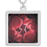 Conceptual image of a womb containing twins square pendant necklace
