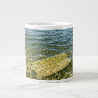 Concrete slab in pond large coffee mug